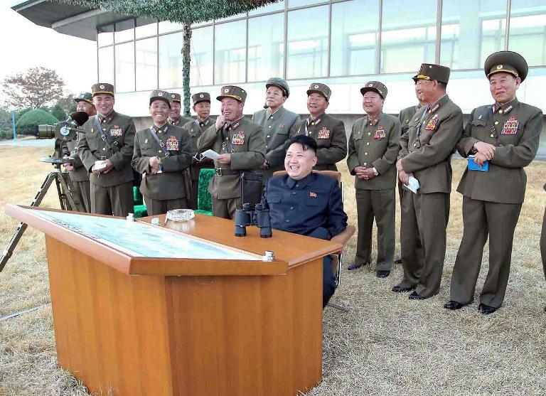 North Korean leader Kim Jong-Un (C) during a firepower strike drill of the Korean People's Army at an undisclosed location, November 1, 2013