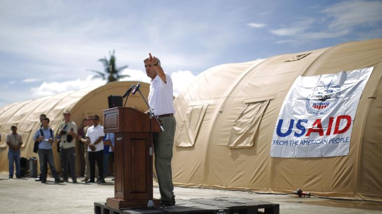 U.S. Secretary of State Kerry delivers remarks during a tour of the damage from super typhoon Haiyan in Tacloban