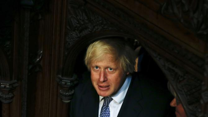The Mayor of London, and Conservative Party MP,  Boris Johnson looks up as he listens to Britain's Queen Elizabeth deliver the Queen's Speech to the House of Lords in the Palace of Westminster, during the State Opening of Parliament in London