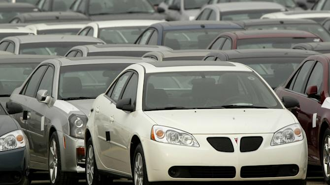 FILE - In this March 16, 2005 file photo, a Pontiac G6 is shown outside the General Motors Orion Assembly plant in Orion Township, Mich.  U.S. safety regulators are looking at expanding a small recall of Pontiac G6 midsize cars so it includes up to 550,000 vehicles. About 8,000 of the cars were recalled by General Motors in 2009 because the brake lights and cruise control didn't work properly. But the recall affected only cars made in January of 2005. On Friday, Feb. 8, 2013, the U.S. National Highway Traffic Safety Administration said in documents posted on its website that it's studying whether all G-6s from the 2005 through 2009 model years should be added to the recall. (AP Photo/Paul Sancya, file)