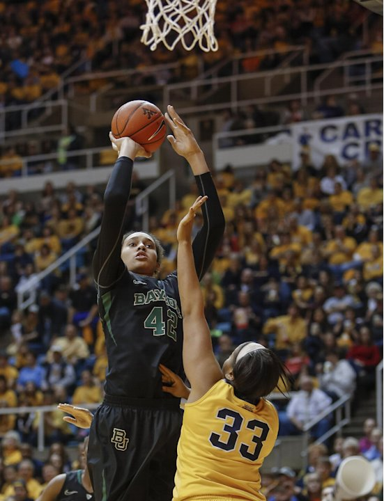 Baylor's Brittney Griner (42) shoots over West Virginia's Ayana Dunning (33) during the first half of an NCAA college basketball game in Morgantown, W.Va., on Saturday, March 2, 2013. (AP Photo/David