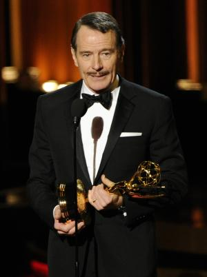 "FILE - In this Monday, Aug. 25, 2014 photo, Bryan Cranston accepts the award for outstanding lead actor in a drama series for his work in ""Breaking Bad"" at the 66th Annual Primetime Emmy Awards at the Nokia Theatre L.A. Live, in Los Angeles. The Nielsen company said the Emmys were watched by 15.6 million people, six million more than ""America's Got Talent,"" the second-ranked show. (Photo by Chris Pizzello/Invision/AP, file)"