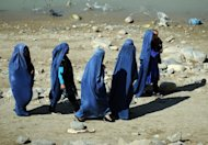 File photo of Afghan women in a park in Kabul. Afghan President Hamid Karzai has ordered the release of a woman who was jailed for adultery after being raped following outcry over the case. However, the woman now faces having to marry her attacker
