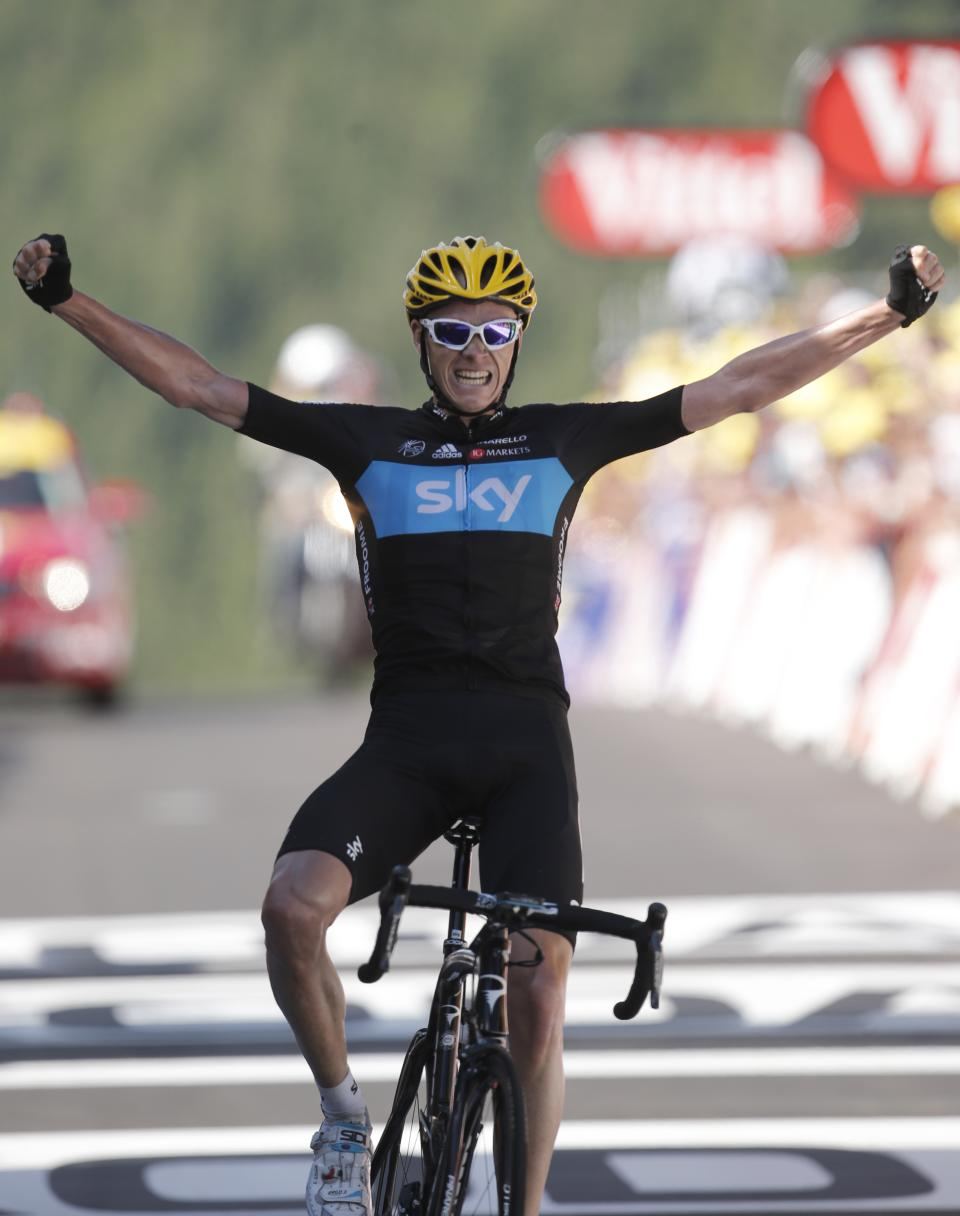 Christopher Froome of Britain crosses the finish line to win the seventh stage of the Tour de France cycling race over 199 kilometers (123.6 miles) with start in Tomblaine and finish in La Planche des Belles Filles, France, Saturday July 7, 2012. (AP Photo/Laurent Rebours)