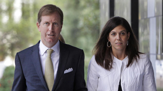 Laura Pendergest-Holt, former chief investment officer for R. Allen Stanford's now defunct financial empire, right, and attorney Chris Flood arrive at the Bob Casey Federal Courthouse Thursday, June 21, 2012, in Houston. Pendergest-Holt, 38, pleaded guilty for her role in helping the once jet-setting businessman bilk investors out of more than $7 billion. As part of an agreement with federal prosecutors, Pendergest-Holt pleaded guilty to one count of obstruction of a U.S. Securities and Exchange Commission proceeding in exchange for a three-year prison sentence. (AP Photo/Houston Chronicle, Melissa Phillip)