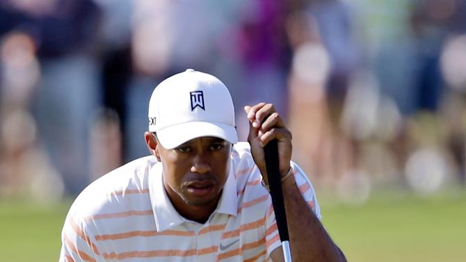 Tiger Woods looks over his putt on the ninth green during the second round of the Cadillac Championship golf tournament Friday, March 8, 2013, in Doral, Fla. (AP Photo/Alan Diaz)