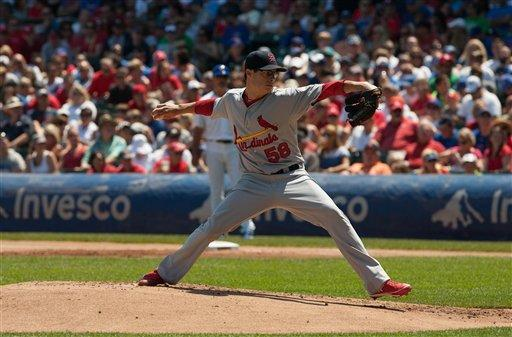 Johnson's bunt in 7th pushes Cubs past Cardinals
