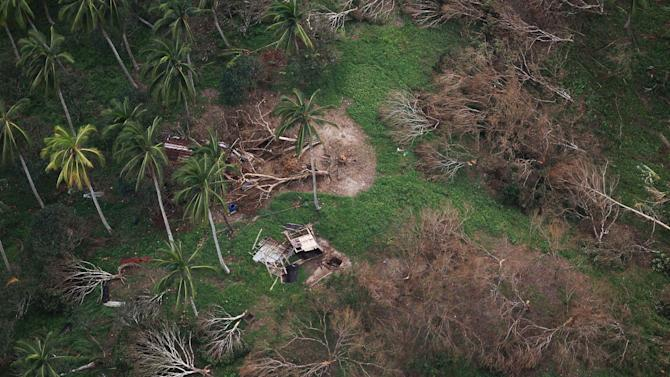 In this photo released by the Malacanang Photo Bureau shows the remains of a house after flash floods caused by a powerful typhoon hit Compostela Valley, southern Philippines on Friday Dec. 7, 2012. Rescuers were digging through mud and debris to retrieve more bodies strewn across a farming valley in the southern Philippines by a powerful typhoon. The death toll from the storm has surpassed 500, with more than 400 people missing.(AP Photo/Jay Morales, Malacanang Photo Bureau, HO)