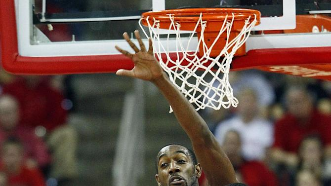 North Carolina State's C.J. Leslie (5) prepares to block the shot of Duke's Quinn Cook (2) during the second half of an NCAA college basketball game in Raleigh, N.C., Saturday, Jan. 12, 2013. (AP Photo/Karl B DeBlaker)