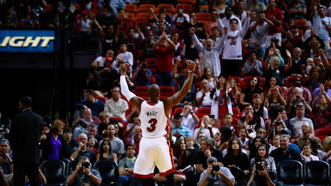 James, Bosh lift Heat past Wizards 103-93
