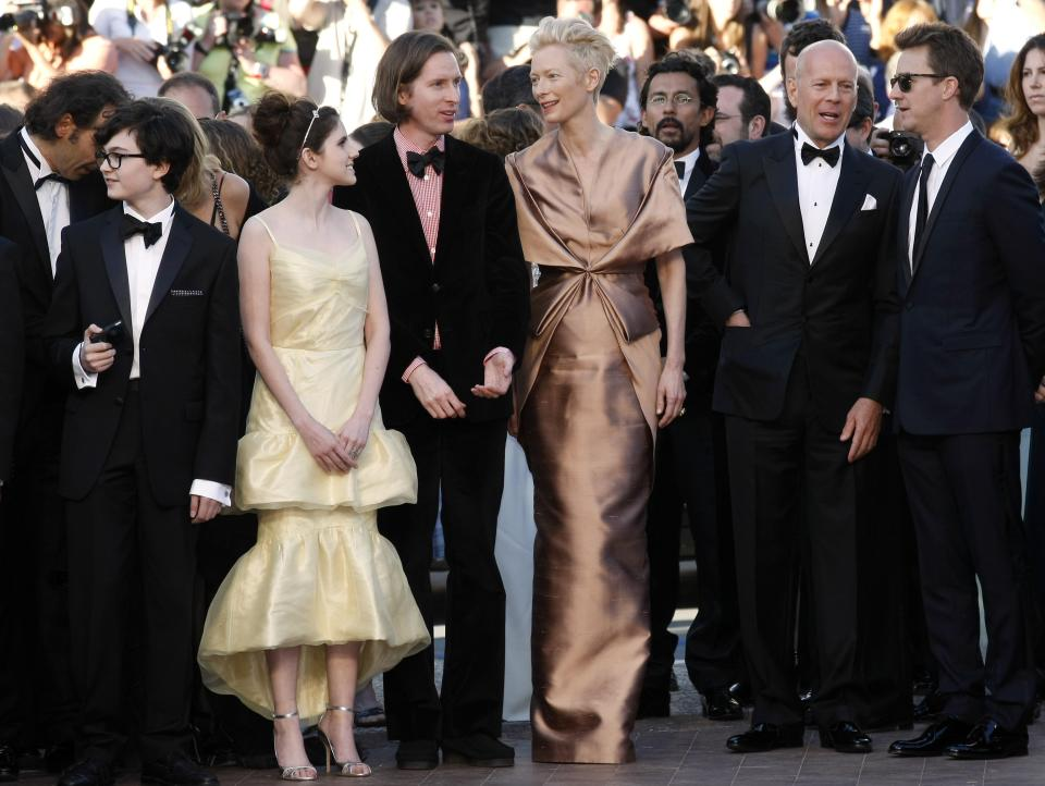 From left actors, Jared Gilman, Kara Hayward, director Wes Anderson, actors Tilda Swinton, Bruce Willis and Edward Norton arrive for the opening ceremony and screening of Moonrise Kingdom at the 65th international film festival, in Cannes, southern France, Wednesday, May 16, 2012. (AP Photo/Lionel Cironneau)