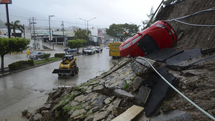 21 dead as tropical storm, hurricane batter Mexico