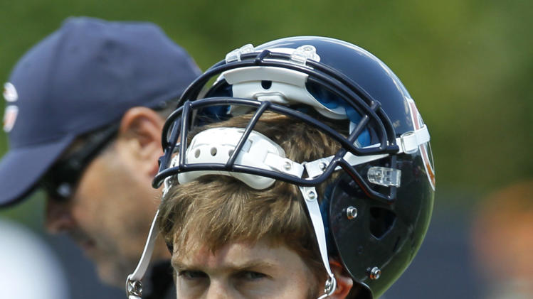 Chicago Bears quarterback Jay Cutler walks off the field after throwing an interception during NFL football practice Tuesday, June 12, 2012 in Lake Forest, Ill. (AP Photo/Charles Rex Arbogast)