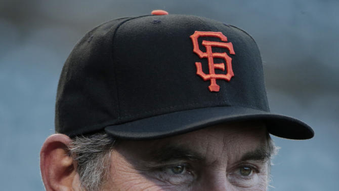 San Francisco Giants manager Bruce Bochy watches over a workout for baseball's World Series Tuesday, Oct. 23, 2012, in San Francisco. The Giants play the Detroit Tigers in Game 1 on Wednesday, Oct. 24. (AP Photo/Charlie Riedel)