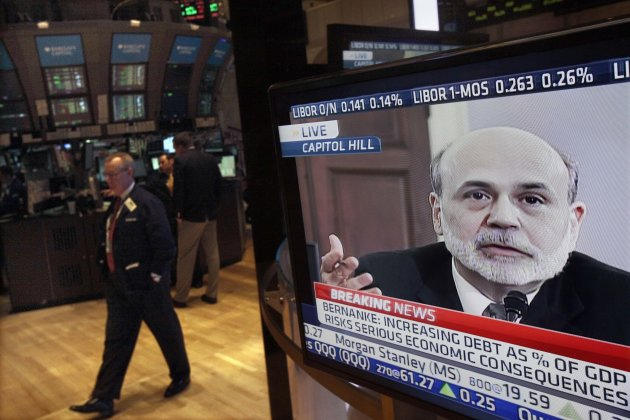 FILE - In a Feb. 2, 2012 file photo Federal Reserve Chairman Ben Bernanke's testimony before the House Budget Committee is visible on a television screen on the floor of the New York Stock Exchange. The Federal Reserve appears to be moving toward announcing some new step to try to energize the troubled U.S. economy. (AP Photo/Richard Drew, file)