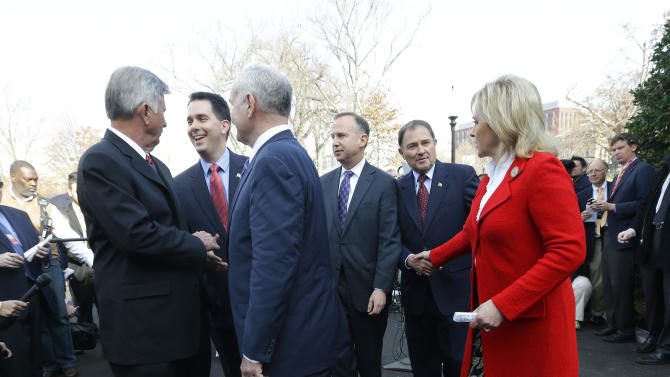 Members of the National Governors Association (NGA) Executive Committee, from left, Arkansas Gov. Mike Beebe; Wisconsin Gov. Scott Walker; Minnesota Gov. Mark Dayton; Chairman, Delaware Gov. Jack Markell; Utah Gov. Gary Herbert; and Vice Chair Oklahoma Gov. Mary Fallin, leave together after speaking to members of the media outside the West Wing of the White House in Washington, Tuesday, Dec. 4, 2012, following their meeting with President Barack Obama regarding the fiscal cliff. (AP Photo/Pablo Martinez Monsivais)
