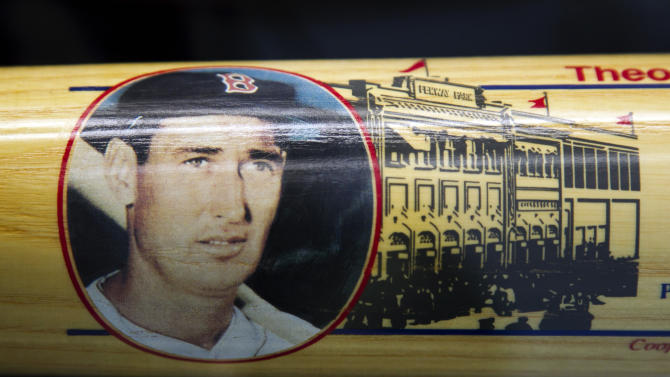 A likeness of Boston Red Sox's Ted Williams decorates a Cooperstown baseball bat in a display case at Fenway Park during an auction preview of items once owned by Williams, Wednesday, April 25, 2012, in Boston. Fans are able to see hundreds of items during the preview which is to last through Friday. The auction is to be held Saturday, April 28. (AP Photo/Steven Senne)