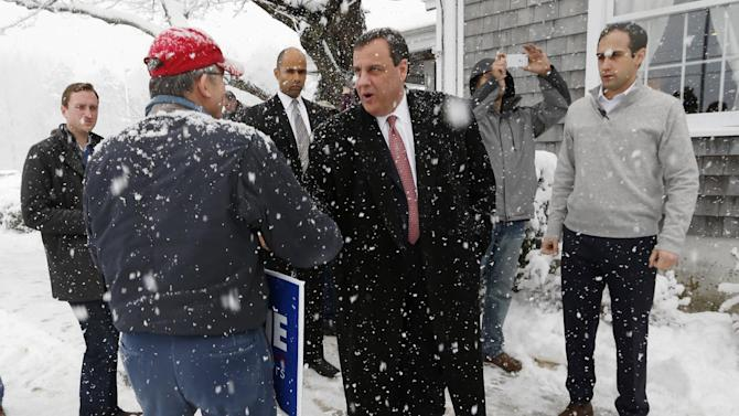 Republican presidential candidate, New Jersey Gov. Chris Christie greets a supporter during a snow storm at a campaign stop at the Strafford Farms Restaurant, Friday, Feb. 5, 2016, in Dover, N.H. (AP Photo/Robert F. Bukaty)