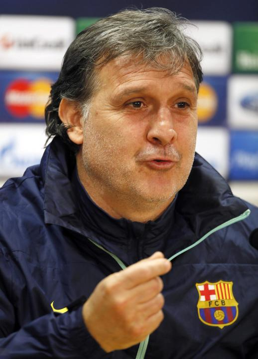Barcelona's coach Gerardo Tata Martino speaks during a news conference at Ciutat Esportiva Joan Gamper in Sant Joan Despi ahead of their Champions League last 16 second leg soccer match against Ma