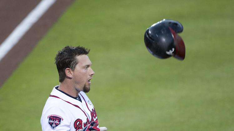 Atlanta Braves third baseman Chris Johnson (23) throws his helmet after striking out with the base loaded to end the first inning of a baseball game against the Philadelphia Phillies Tuesday, Sept. 2, 2014, in Atlanta. (AP Photo/John Bazemore)