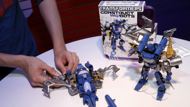 A demonstrator assembles a TRANSFORMERS CONSTRUCT-BOTS ELITE set in Hasbro's showroom at the American International Toy Fair, Saturday, Feb. 9, 2013, in New York. (Photo by Jason DeCrow/Invision for Hasbro/AP Images)