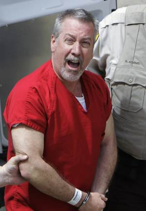 FILE - In this May 8, 2009 file photo, former Bolingbrook, Ill., police sergeant Drew Peterson yells to reporters as he arrives at the Will County Courthouse in Joliet, Ill. Peterson, in jail charged with murder in the 2004 death of Kathleen Savio and a suspect in the disappearance of his fourth wife Stacy Peterson, is trying to stop a television movie about him. Peterson's attorney says he's sent a letter to those involved with the movie saying that the commercial use of Peterson's name, likeness and story are illegal because Peterson didn't give his written authorization as required by law. (AP Photo/M. Spencer Green, File)