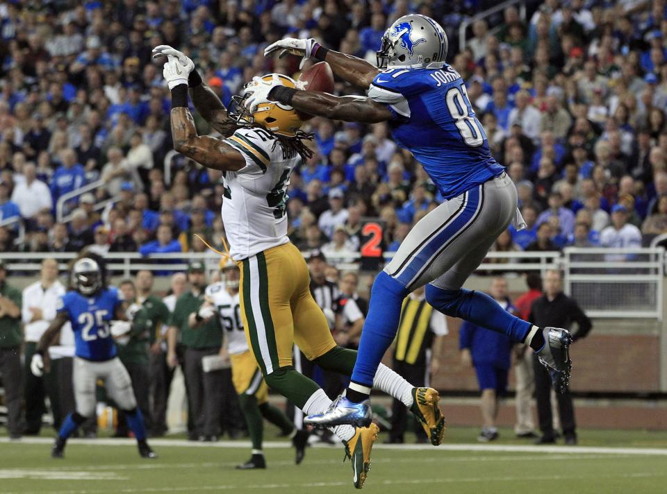 Detroit Lions wide receiver Calvin Johnson (81) pulls in a 25-yard touchdown reception as Green Bay Packers free safety Morgan Burnett (42) defends in the third quarter of their NFL football game in Detroit, Sunday, Nov. 18, 2012.  (AP Photo/Carlos Osorio)
