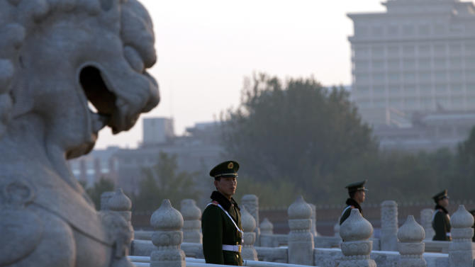 In this photo taken Tuesday, Nov. 6, 2012, Chinese paramilitary policemen guard the bridges leading to Tiananmen Gate in Beijing. Authorities want no more surprises as party leaders convene in the capital, and rights groups say the wide-ranging crackdown on critics bodes poorly for those who hope the incoming generation of leaders will loosen restrictions on activism. (AP Photo/Alexander F. Yuan)