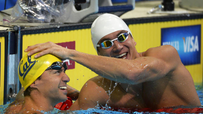 Anthony Ervin, left, and Nathan Adrian react after swimming in the men's 50-meter freestyle preliminaries at the U.S. Olympic swimming trials, Saturday, June 30, 2012, in Omaha, Neb. (AP Photo/Mark J. Terrill)
