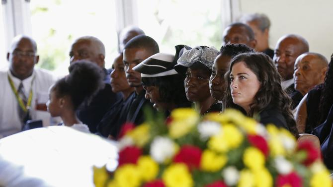 The family of Mario Deane attend his funeral in Montego Bay