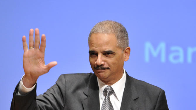 """Attorney General Eric Holder waves to the audience as he is introduced before speaking at the Northwestern University law school, Monday, March 5, 2012 in Chicago. Holder said Monday that the decision to kill a U.S. citizen living abroad who poses a terrorist threat """"is among the gravest that government leaders can face,"""" but justified lethal action as legal and sometimes necessary in the war on terror. (AP Photo/Brian Kersey)"""