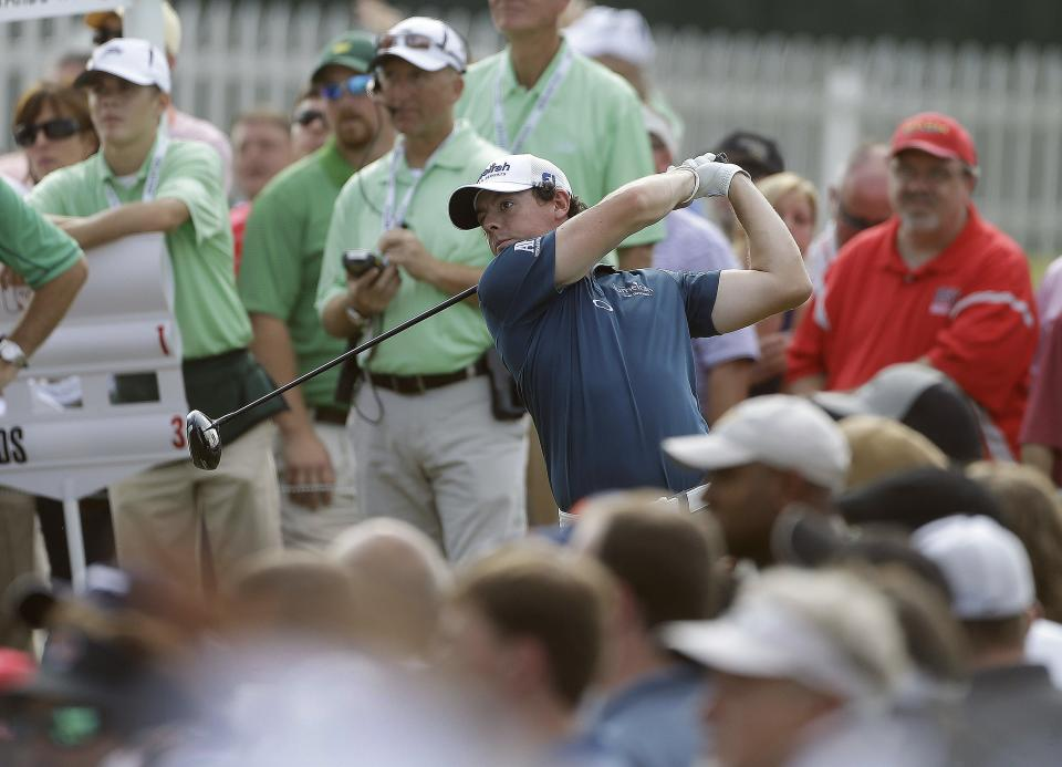 Rory McIlroy, of Northern Ireland, hits from the tee on the 13th hole during the first round of the Tour Championship golf tournament in Atlanta on Thursday, Sept. 20, 2012. (AP Photo/John Bazemore)