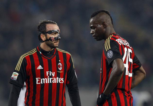 AC Milan's Pazzini and Balotelli react during their Italian Serie A soccer match against Udinese at Friuli stadium in Udine