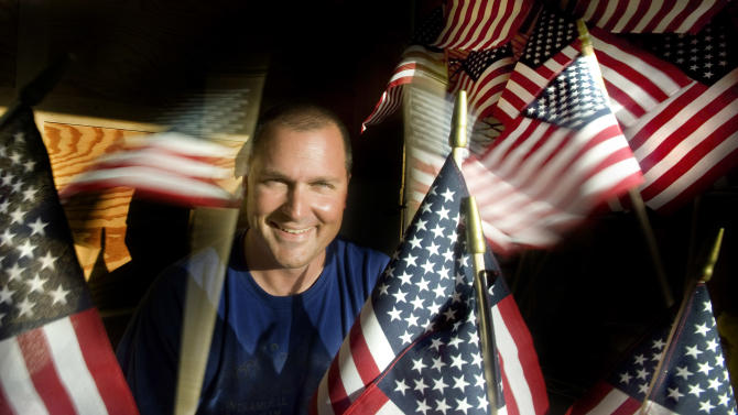 """Air Force veteran and Anaheim police officer Brennan Leininger was """"saddened"""" last Memorial Day when he realized more than half the 150,000 graves at Riverside National Cemetery did not have flags. He raised more than $15,000 and was able to purchase 21,600 flags that he and about 300 Orange County volunteers will place on graves Saturday May 26, 2012. Next year he hopes to be able to raise enough money to adorn all 150,000. """"A lot of people just think it gets done,"""" he said. (AP Photo/Mindy Schauer, Orange County Register)"""