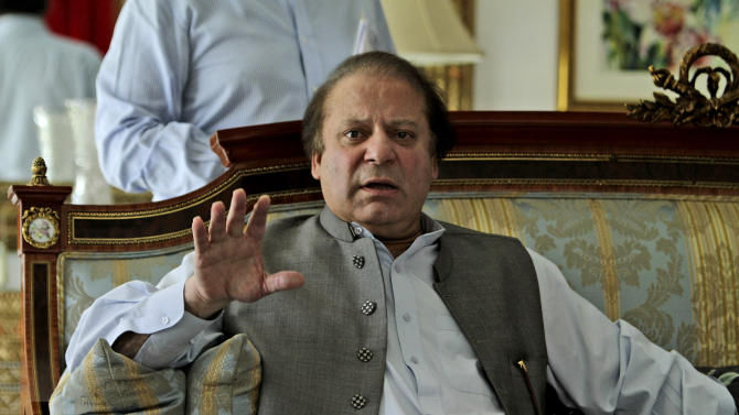 """Former prime minister and leader of Pakistan Muslim League-N party, Nawaz Sharif, gestures while speaking to members of the media at his residence in Lahore, Pakistan, Monday, May 13, 2013. The Pakistani politician poised to become the country's next prime minister said Monday that Islamabad has """"good relations"""" with the United States, but called the CIA's drone campaign in the country's tribal region a challenge to national sovereignty. (AP Photo/K.M. Chaudary)"""
