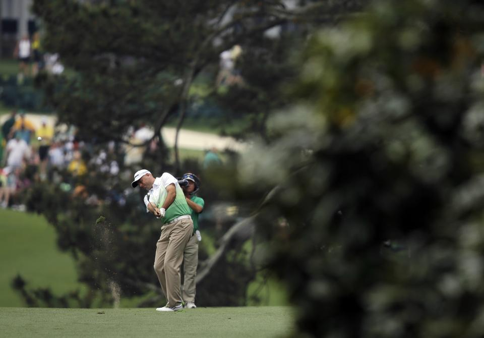 Stewart Cink hits off the first fairway during the first round of the Masters golf tournament Thursday, April 11, 2013, in Augusta, Ga. (AP Photo/Matt Slocum)