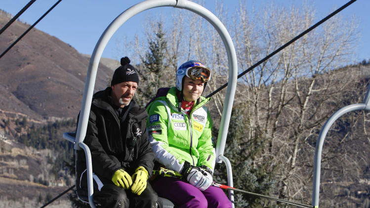 Lindsey Vonn, right, of the United States, rides a chair lift with her ski service personnel during practice for the women's World Cup ski race in Aspen, Colo. on Friday, Nov. 23, 2012. (AP Photo/Alessandro Trovati)