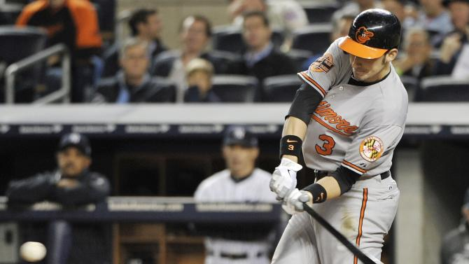 Baltimore Orioles' Ryan Flaherty swings on a home run during the third inning of Game 3 of the Orioles' American League division baseball series against the New York Yankees on Wednesday, Oct. 10, 2012, in New York. (AP Photo/Bill Kostroun)