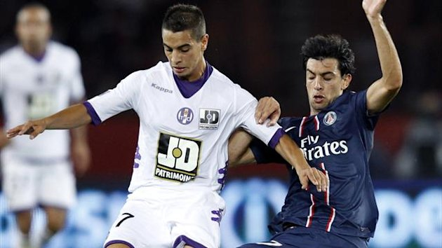 Paris St Germain's Javier Pastore (R) challenges Wissam Ben Yedder of Toulouse (Reuters)