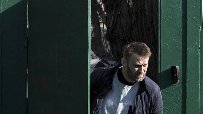 Russian opposition activist Alexei Navalny leaves a detention center in Moscow, Russia, Friday, March 6, 2015. Navalny was detained earlier in February for 15 days for distributing leaflets for an anti-government march. (AP Photo/Pavel Golovkin)