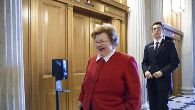 FILE - This March 24, 2014 file photo shows Senate Appropriations Committee Chair Sen. Barbara Mikulski, D-Md. walking on Capitol Hill in Washington. A bipartisan coalition on the Senate Appropriations Committee moved Thursday to roll back House GOP-backed cuts to Amtrak, transportation projects, and affordable housing projects, but pressures elsewhere in the budget may make the funding levels unsustainable as the massive $108 billion spending bill moves ahead. (AP Photo/J. Scott Applewhite, File)