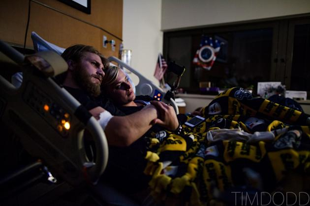 Taylor Morris and Danielle Kelly still cuddle watching a movie at Walter Reed Medical Academy in Washington