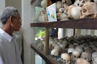 A Cambodian looks at skulls displayed at the Tuol Sleng genocide museum in Phnom Penh on August 31, 2009. Led by Pol Pot, who died in 1998, the Khmer Rouge wiped out up to two million people -- nearly a quarter of the population -- through starvation, overwork or execution in a bid to create an agrarian utopia