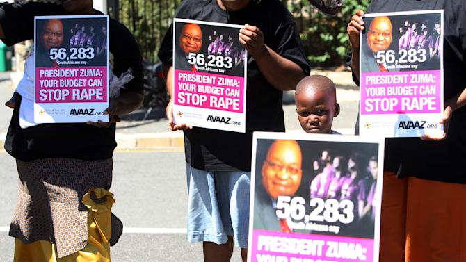 """IMAGE DISTRIBUTED FOR AVAAZ - People gather near Parliament to highlight the country's high incidence of rape and call on President Jacob Zuma to take urgent action to address this crisis while Minister of Finance Gordhan presented his budget to Parliament in Cape Town, South Africa, on Wednesday, Feb. 27, 2013. Hundreds of item's of women's clothing were hung on a washing line to symbolise the estimated 3,600 women assaulted on a daily basis in South Africa, one every 24 seconds. More than 130 protestors gathered, carrying banners stating """"3,600 every day is a crisis. President Zuma: your budget can stop rape"""". Avaaz is a global campaign movement that promotes action on issues such as climate change, human rights, animal rights, corruption, poverty, and conflict. The movement operates in 17 languages, and has more than nineteen million members. (AP Images for Avaaz)"""