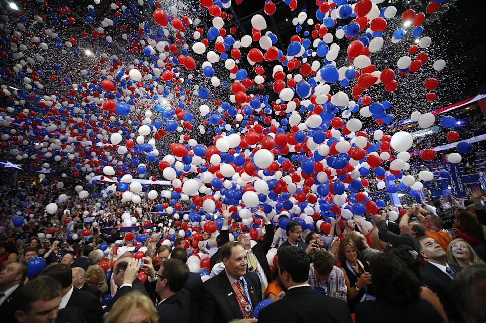 Balloons fall as Republican presidential nominee Mitt Romney and Republican vice presidential nominee, Rep. Paul Ryan's families take the stage at the Republican National Convention in Tampa, Fla., on Thursday, Aug. 30, 2012. (AP Photo/Jae C. Hong)