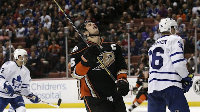 Anaheim Ducks' Ryan Getzlaf, center, reacts after missing a shot during the second period of an NHL hockey game against the Toronto Maple Leafs on Monday, March 10, 2014, in Anaheim, Calif