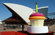A giant birthday cup cake is displayed on the steps of the Sydney Opera House as the world heritage-listed building celebrates its 40th birthday, on October 20, 2013