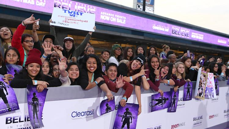 "Fans cheer at the World Premiere of Open Road's ""Justin Bieber's Believe"" presented by Teen Vogue and sponsored by Clearasil, on Wednesday, Dec. 18, 2013 in Los Angeles. (Photo by Alexandra Wyman/Invision for Open Road Films/AP Images)"