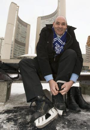 FILE - In this Jan. 8, 2010, file photo, George Smitherman laces up his skates in front of City Hall after registering to be a candidate in the Toronto mayoral race in Toronto. Smitherman, an openly gay liberal who overcame an admitted history of drug use to become Ontario's deputy premier, is the man Toronto Mayor Rob Ford defeated for the office. Ford's erratic behavior and confessed crack cocaine and alcohol use while in office have led the city council to strip him of most of his powers. (AP Photo/The Canadian Press, Frank Gunn, File)