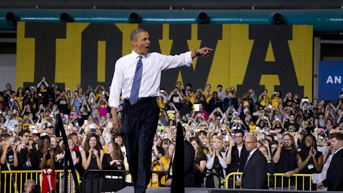 FILE - In this April 25, 2012 file photo, President Barack Obama arrives to speak at the University of Iowa in Iowa City, Iowa. The Iowa magic that launched Barack Obama to the presidency four years ago has all but faded. Today, the Democrat who emerged Cinderella-like in Iowa in 2008 is sharply attacking Republican challenger Mitt Romney's economic credentials and his ability to grasp voters' everyday concerns.  (AP Photo/Carolyn Kaster, File)